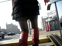 Girl in black stockings and red high boots going upstairs 1
