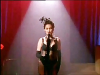 Tia Carrere in stockings and garter belt