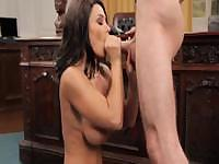 Lisa Ann gts on the desk to suck this guy's hard cock in this video