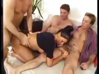 Insatiable Laura Angel works on three cocks and makes them all cum