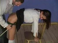 Her Skirt Goes Up for a Strict Caning On Her Bare Ass