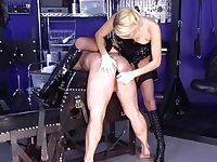Strapon Domme in Boots and Stockings