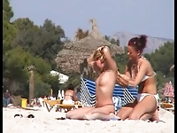 Two topless lesbian girls on the beach