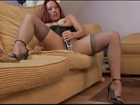 British slut Faye Rampton plays with herself on the sofa
