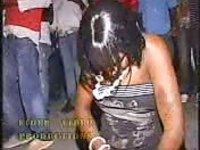Ebony chick masturbates with bottle in public with an audience present