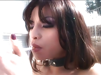 Wild brunette in latex and boots works on two dicks