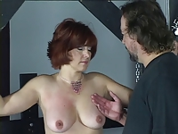 Cute young brunette is restrained and fingered by bdsm slave master
