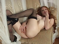 Sexy Redhead in stockings and high heels