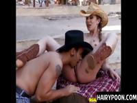 Beautiful and sexy cowgirl spreads her legs