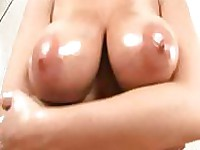 Big breasts getting oily massage