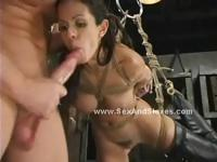 Brunette beautifull babe with large breasts and a sexy round ass hanged in rope and abused