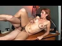 Busty milf Mikela sinuates on a table during hot fuck with her horny friend