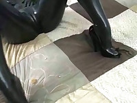 Girl in latex catsuit masturbates