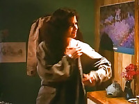 Courteney Cox making out with a guy as he lowers her white tank top and cups her breasts with his hand as we get a shadowy view. We then see her nude completely lying in bed with the guy as they have sex. From Blue Desert.