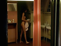 Chloe Sevigny nude as she prepares to shower. We can then see that her character has a penis, which has been digitally generated. After her shower, we see Chloe wearing an open robe and bending over as she hides her penis and pulls on her panties. From Hi