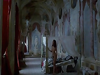 Anne Knecht naked lying on bed while a guy enters an starts having sex with her. Her bare breasts , ass and bush are visible. From Vampire In Venice.