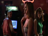 Jodie Foster doing a sexy dance in a jean skirt and a grey top that falls off her shoulders. Then we see Jodie Foster topless laying on a pinball machine as some guys assault her, having sex with her and playing with her breasts. From The Accused.