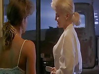 Kristy McNichol seen in a bathroom with her top open, applying makeup to her nipples to accentuate them as Sherilyn Fenn enters the room and they talk. From Two Moon Junction.