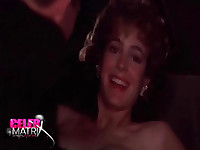 Sean Young making out with a guy in a car with her nipple pops out of her dress. Then Sean Young removing her fur coat and turning around to reveal her breasts while talking to some people from No Way Out.