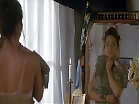 Theresa Russell getting onto a bed and a guy staring between her legs and then later her laying topless on a bed while a guy kisses her chest. From Eureka.
