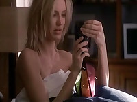 Cameron Diaz having  sex with a guy on a bed. Then we see Cameron Diaz wearing a nightie as she rolls over in bed, her left breast slipping into view in the process as it pops out of her top. From Vanilla Sky.