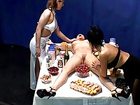 wow dinner with naked girl on a table, mean a hot lesbian party