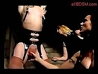 Blonde Girl With Tied Arms Nipples And Pussy Tortured With Clips Pussy Stimulated With Vibrator Spanked By 2 Mistress In The Dungeon