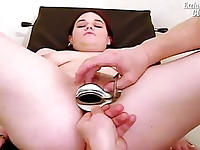 Fresh pussy is slowly opened by speculum