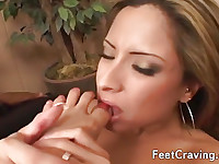 Lovely girl wanks a cock with her feet
