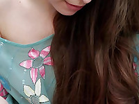 Gorgeous long haired teen honey showing playful shaved pussy outdoors in this stream video.