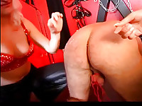 Slave gets spanked by two mistresses