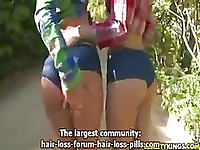 2 sexy girls with a big ass in the forest