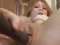 Aroused brunette with lerge bosom masturbates in bedroom with vibrator