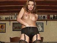 Sluty pornstar in black lingerie and stockings sticks her fingers up her twat
