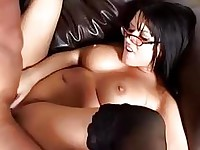 Dark haired hottiw eith glasses rides and sucks stiff beef on couch