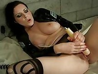 Busty dark haired pornstar in prison plays with vibrators