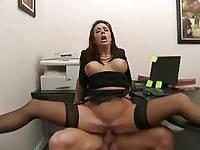 Tattooed busty cougar rides hard boner in office