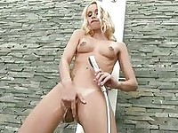 Gorgeous tanned blonde with tattoo fingers her pierced vag under shower