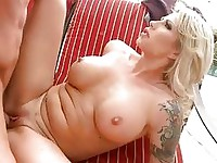 Busty tattooed blonde whore gets her shaved taco rammed outdoor