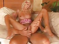 Innocent looking blonde girl rides hard rod on couch