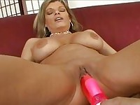 Two blonde playful blondes using vibrators on each other