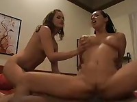 Two turned on girls take their hands on big black cum shooter