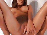 Nympho honey Nicole Graves thumps her tight shaved pussy with her favorite toy
