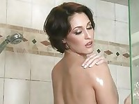 Sexy short haired Ryan Keely soaking her naked body wet in the shower