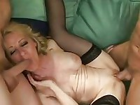 Lusty Robin Pachino enjoys a horny threesome bang on the couch