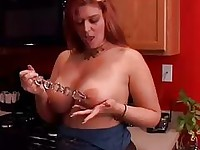 Chubby redhead frigging in the kitchen