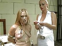 Classy mistress punishing young beauty