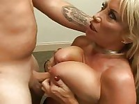 Pretty babe with big boobs riding a dick