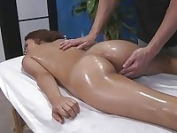 Oiled brunette gets a butt massage
