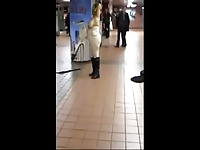 Naked woman in public dancing to subway band
